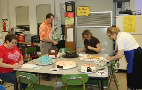 Staff judges student semi-annual cake decorating contest